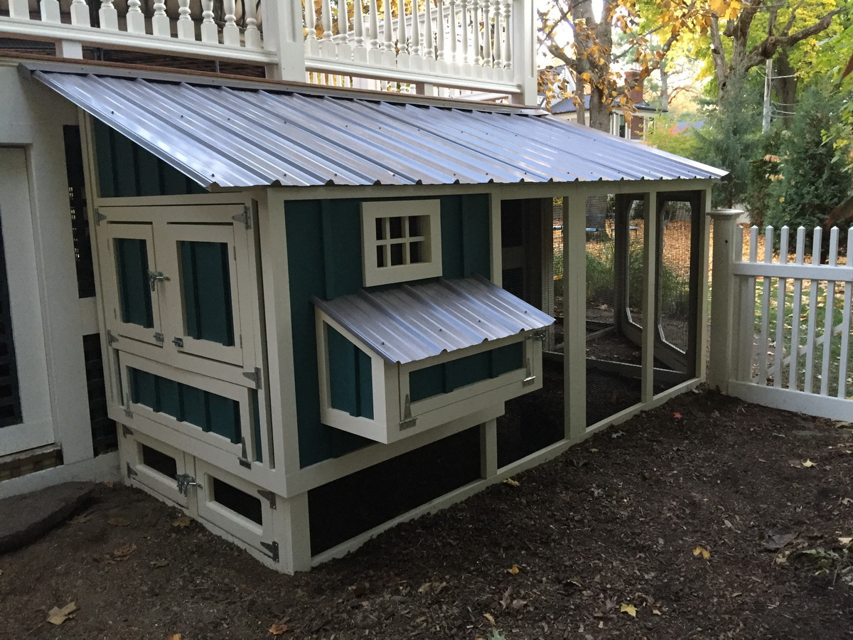 Custom coop under wrap around deck