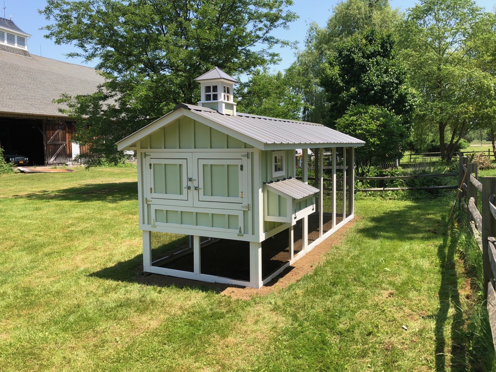 6′ x 12′ Carolina Coop with board & batten siding and cupola in Buffalo, NY