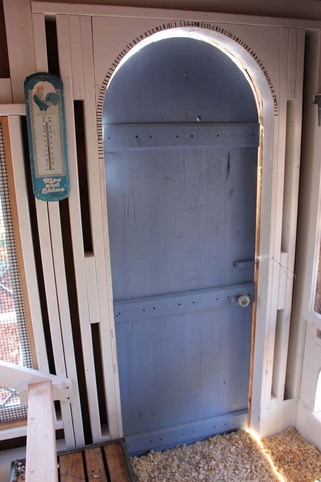 Carolina Coops Custom Coop with reclaimed barnwood and arched door in Raleigh, NC