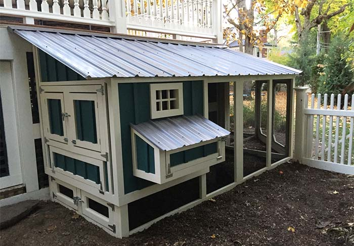Carolina Coops henhouse of wrap around custom coop and run under deck