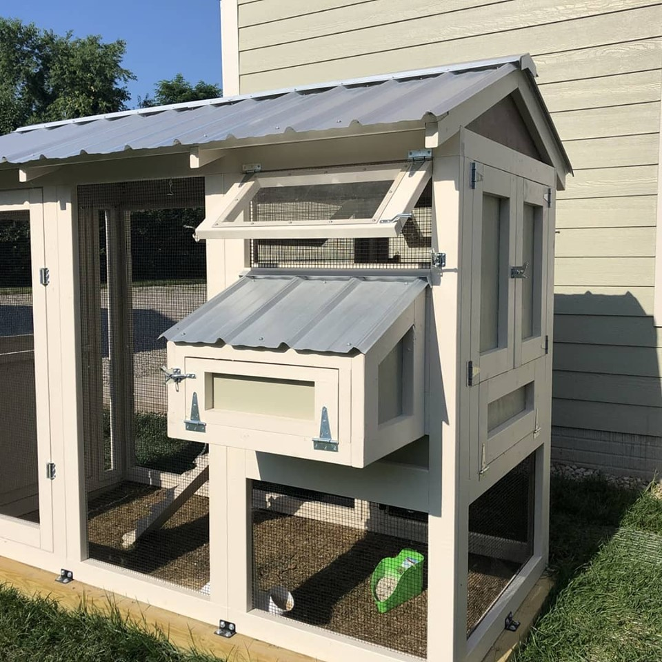 California Coop painted to match the house with a Dutch door and rain barrel waterbar system in Ohio