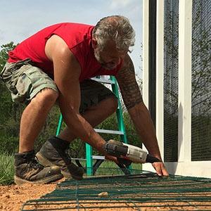 Carolina-Coops-installing a predator apron