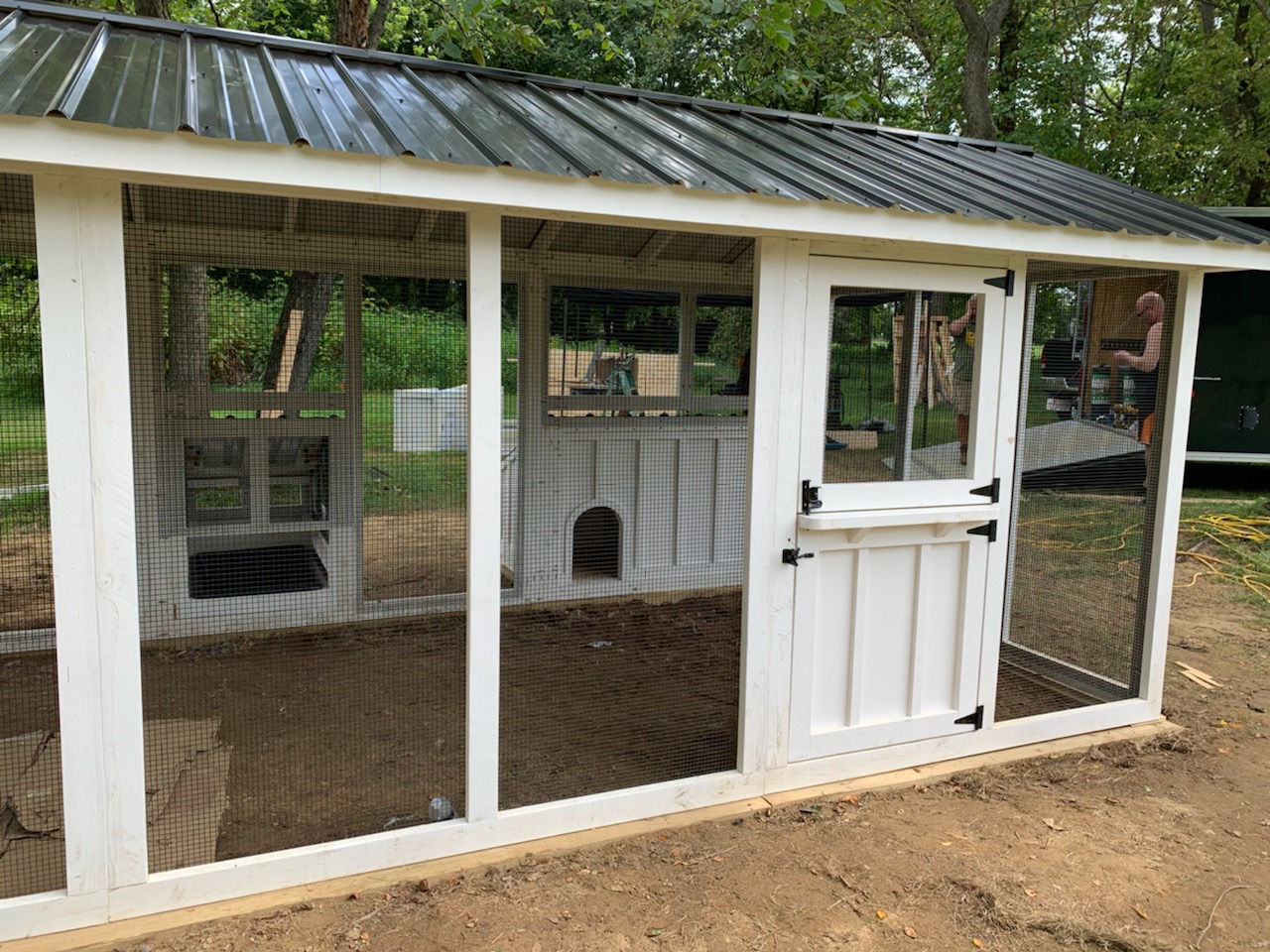 Exterior shot of custom duck and chicken coop with duck dipper