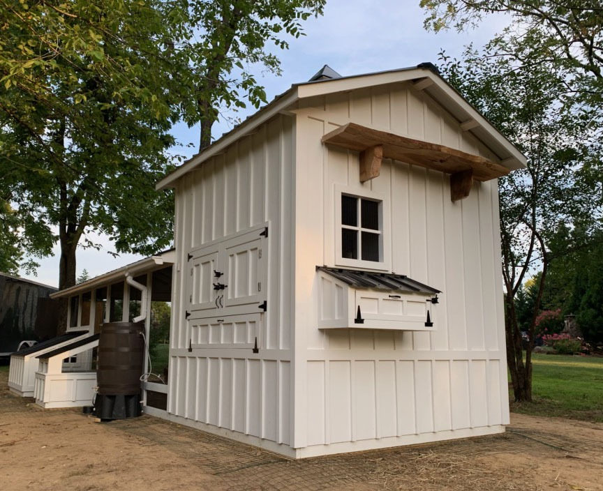 Henhouse view of custom Craftsman Coop with duck house and duck dipper