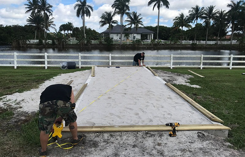 Measuring for the placement of a custom coop build in Delray Beach, Florida