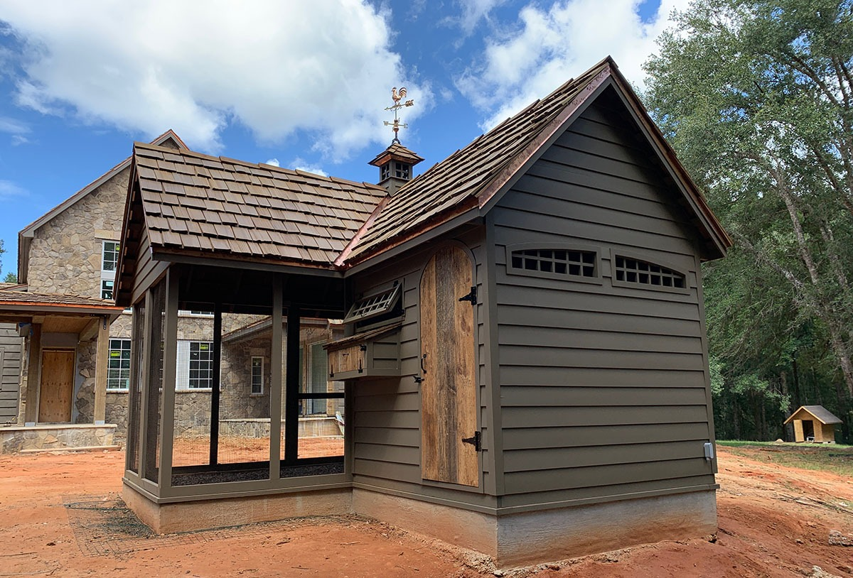 Carolina Coops custom Alabama Chicken Coop built to match the main house with cupola and reclaimed barn wood