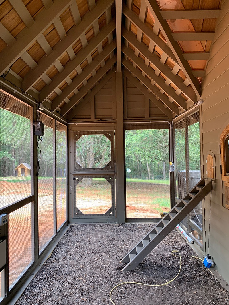 Carolina Coops custom Alabama Chicken Coop inside the run with hand cut cedar shake shingle roofing and reclaimed barn wood