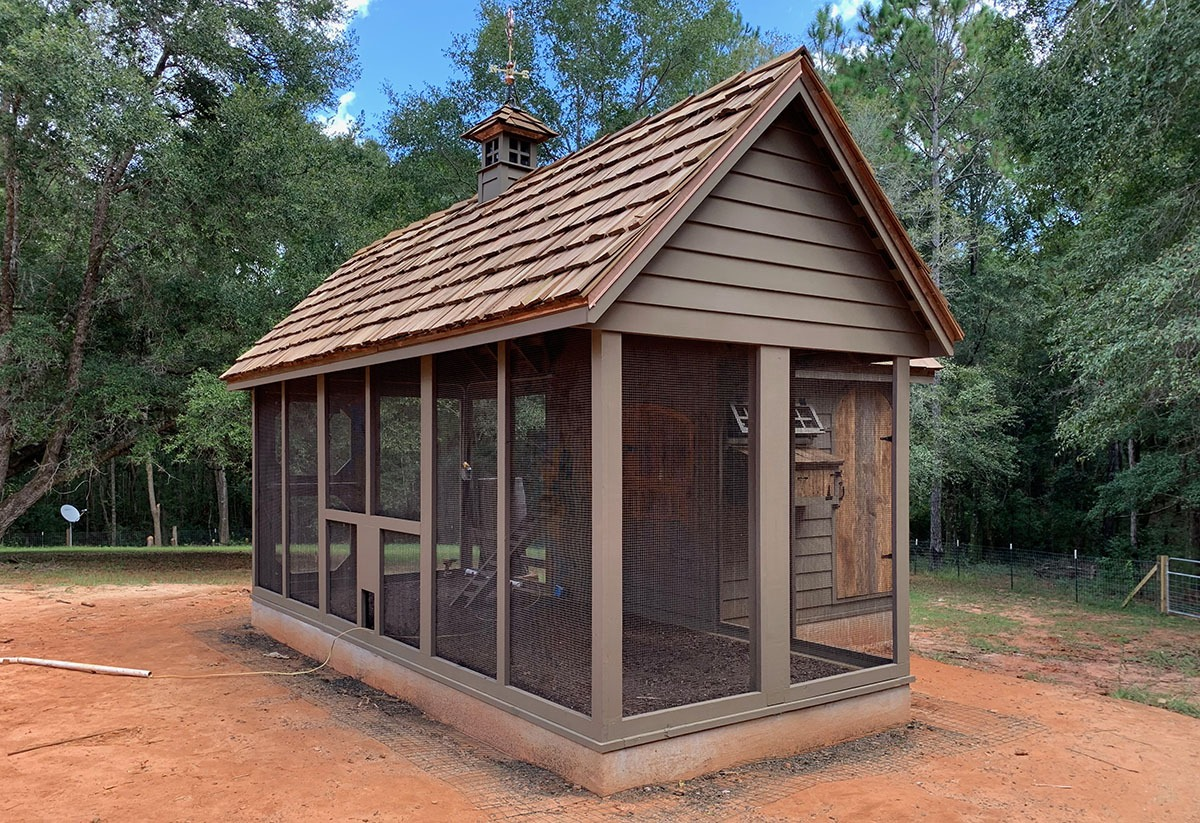 Carolina Coops custom Alabama Coop exterior with perpendicular run and reclaimed barn wood doors and cedar shake roof