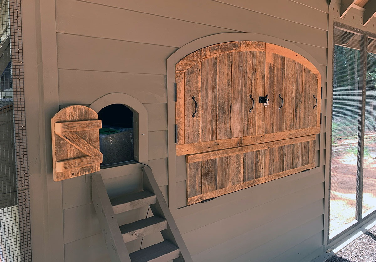 Custom Alabama Coop interior with removable reclaimed barn wood henhouse doors