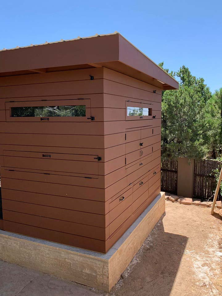 Exterior of a henhouse of a custom modern chicken coop with shiplap siding in Santa Fe, NM