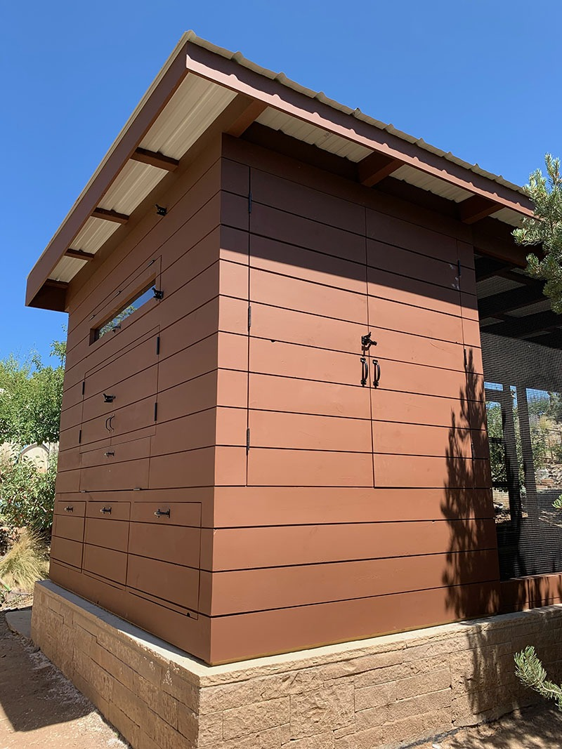 Henhouse of a custom modern chicken coop with shiplap siding in Santa Fe, NM