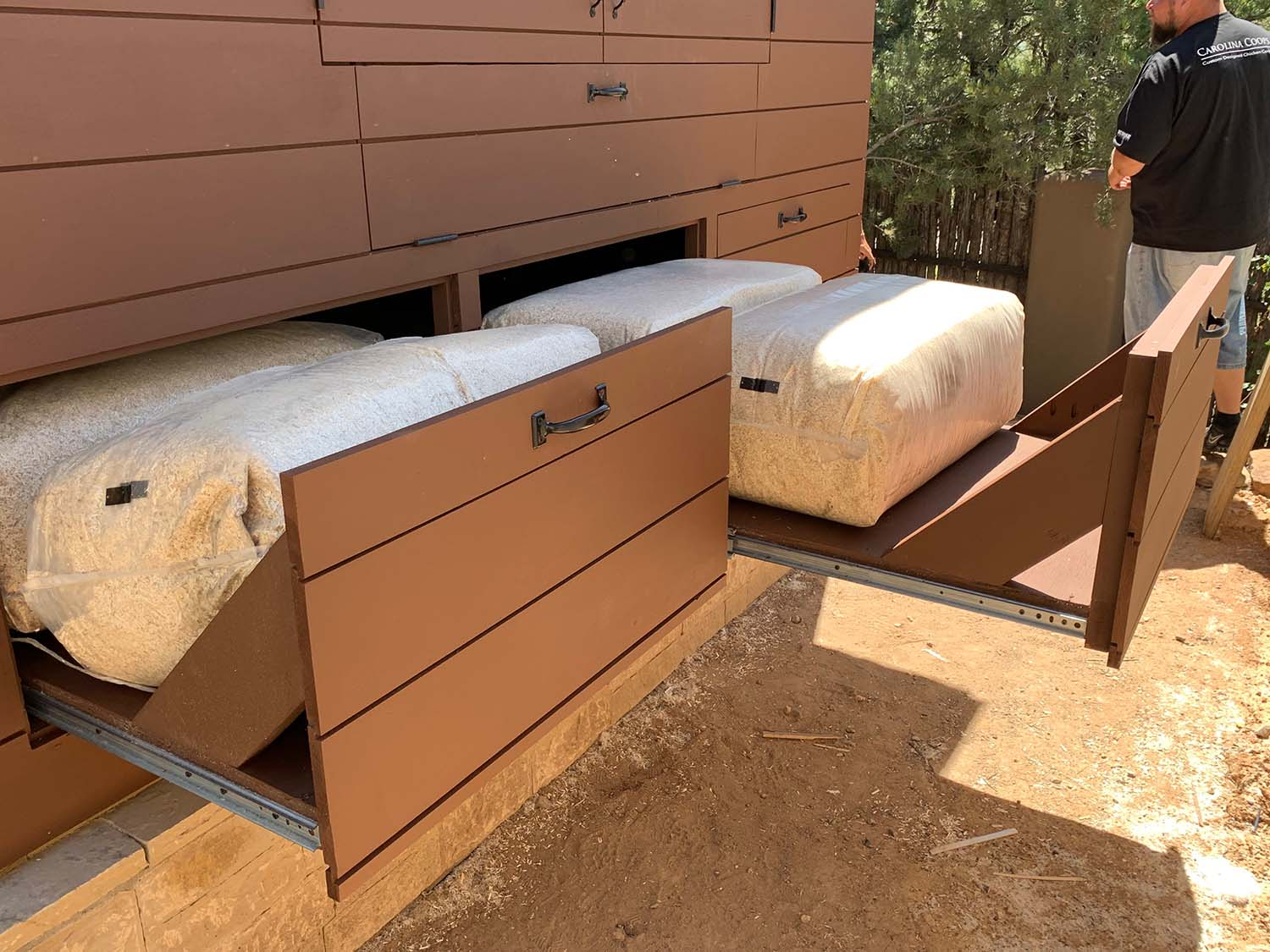 Storage under the henhouse of a modern custom coop in Santa Fe, NM