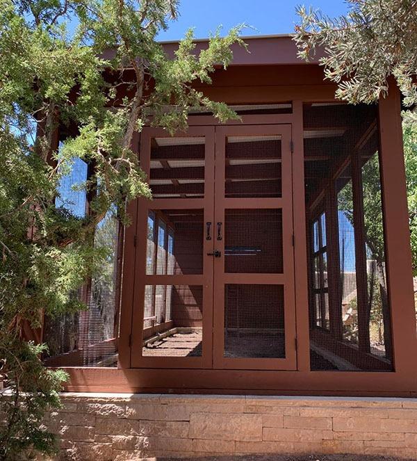 Double doors on a custom modern chicken coop in Santa Fe, NM
