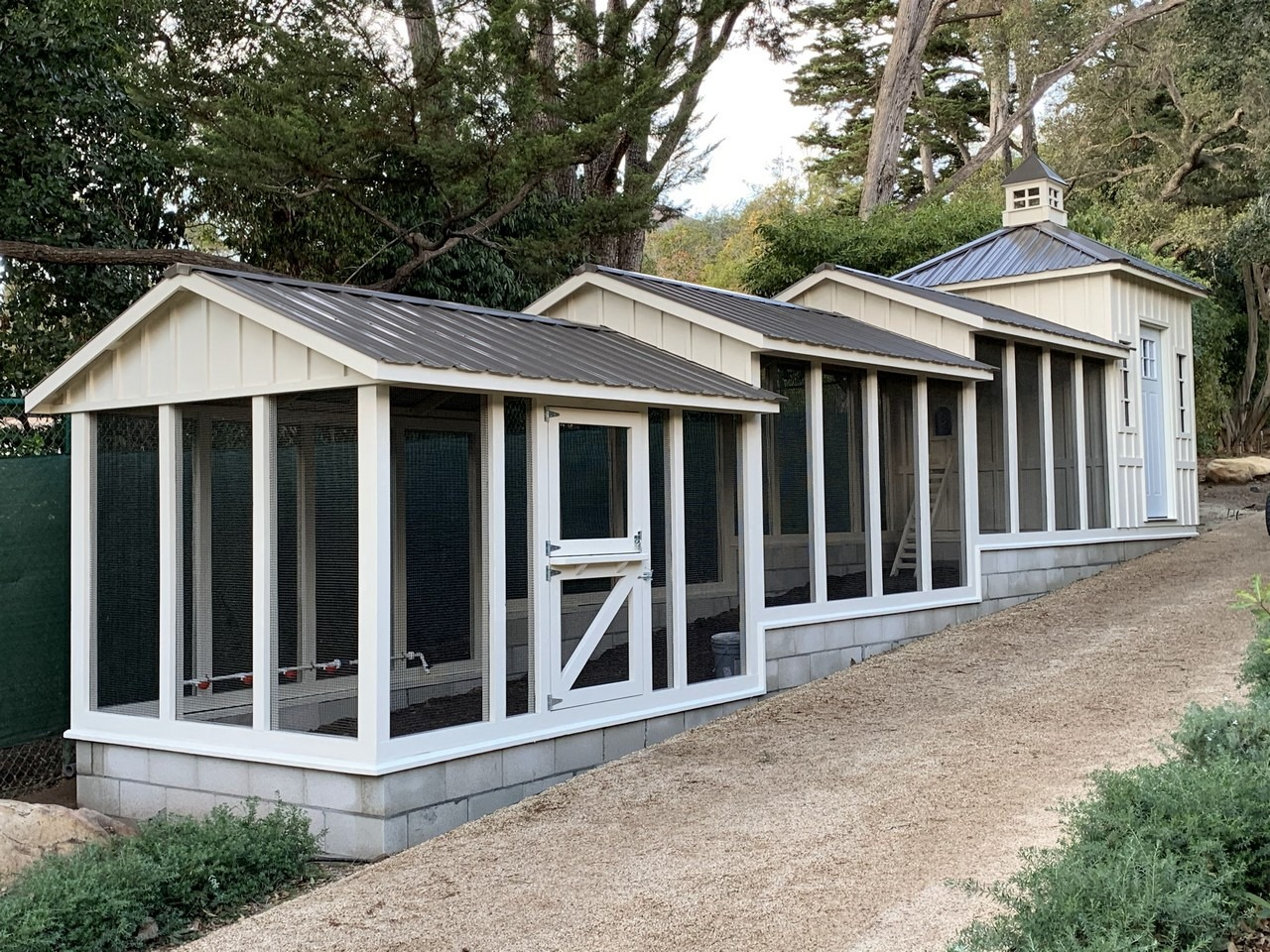 40-foot Craftsman Coop with Dutch door, board and batten siding, and 31.5 foot chicken run in Santa Barbara, CA