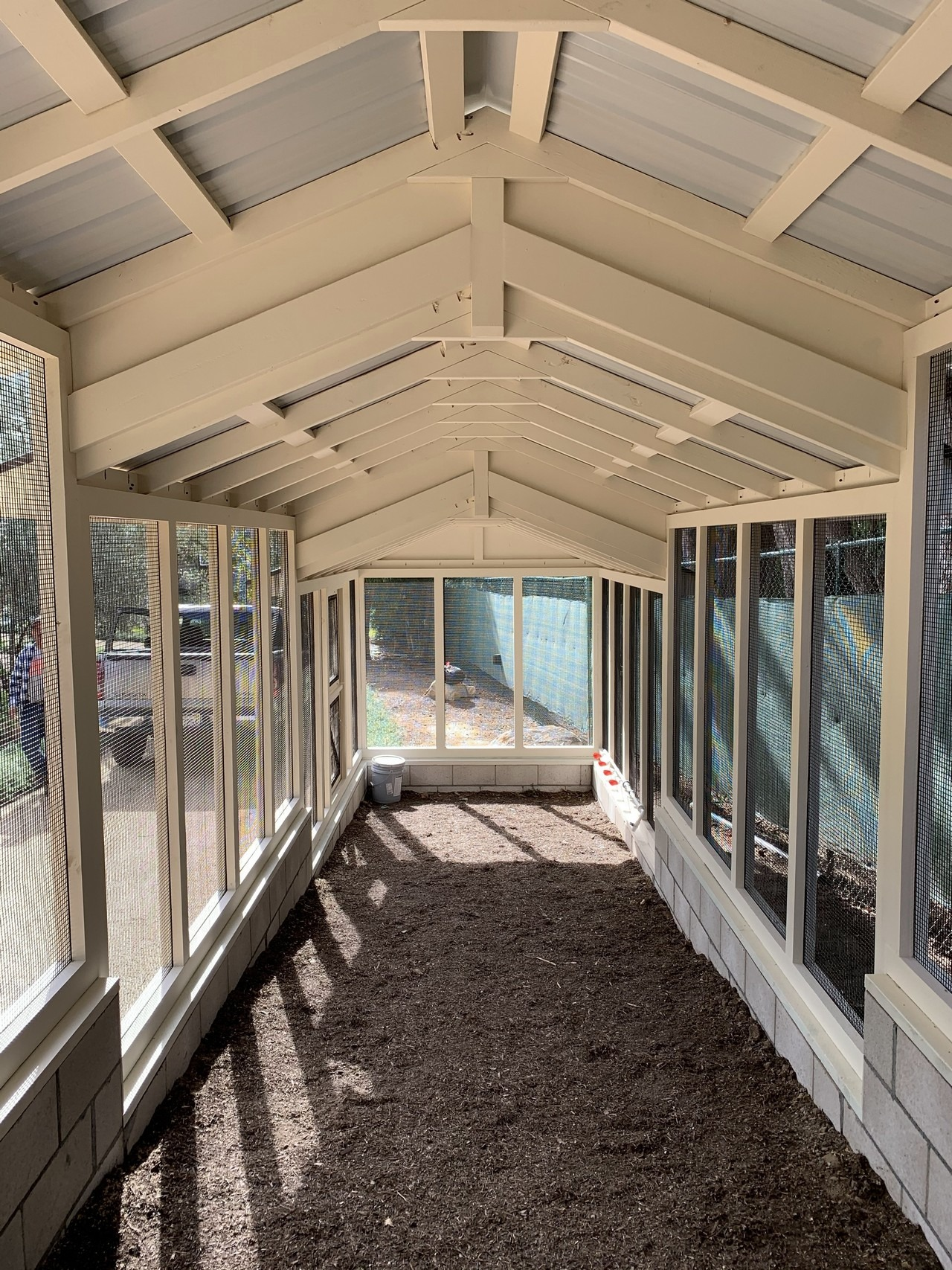 Inside a 32 foot chicken run of a custom Craftsman Coop in Santa Barbara, CA