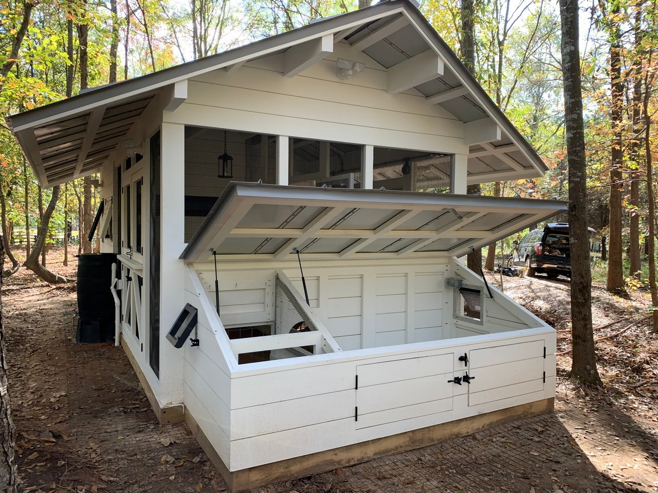 Modern farmhouse chicken and duck coop has a duck dipper for ducks to get their heads wet