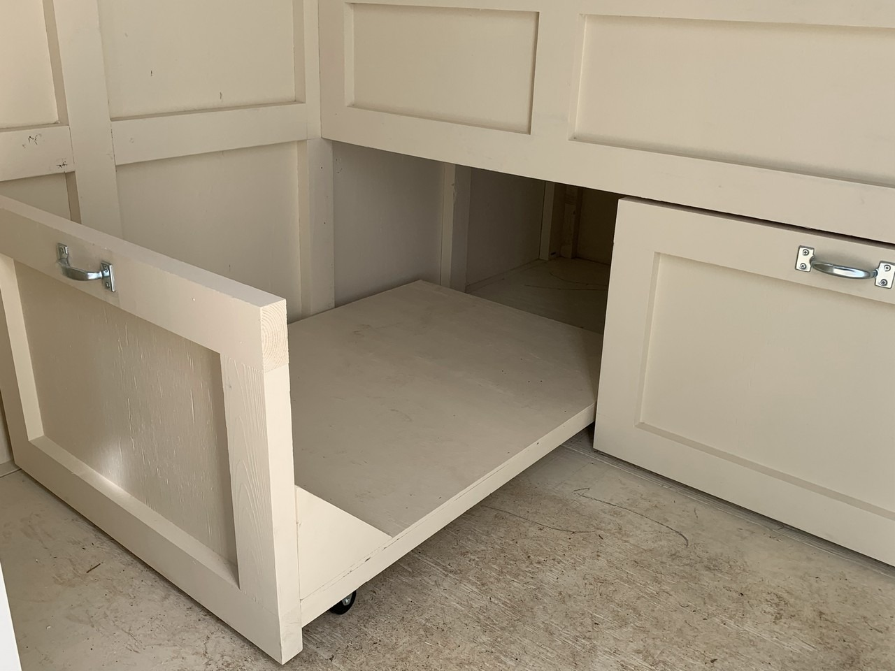 Pull out storage drawers in the shed-henouse combo of a custom Craftsman Coop in Santa Barbara, CA