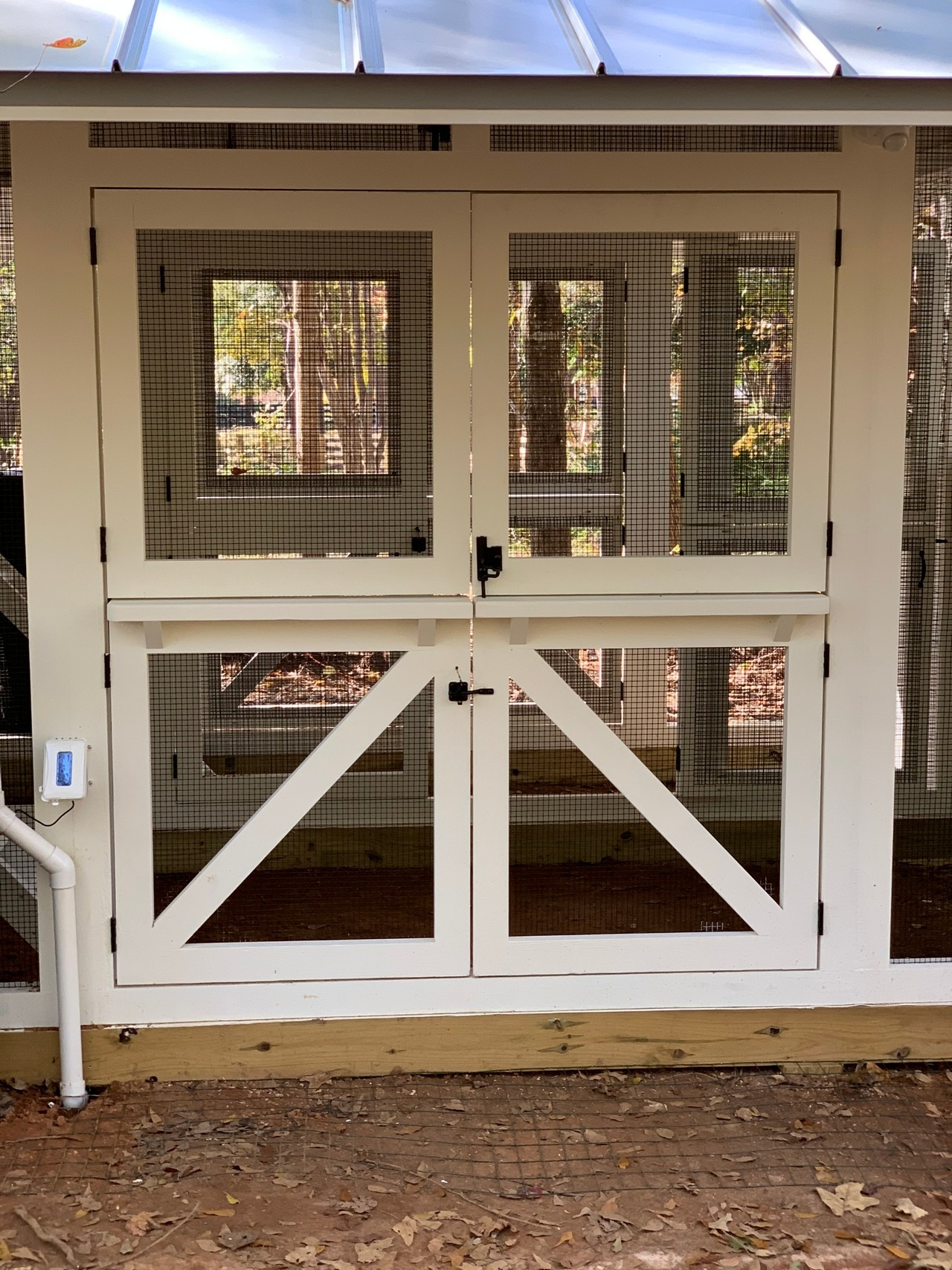 Three sets of double Dutch doors on the modern farmhouse chicken and duck coop