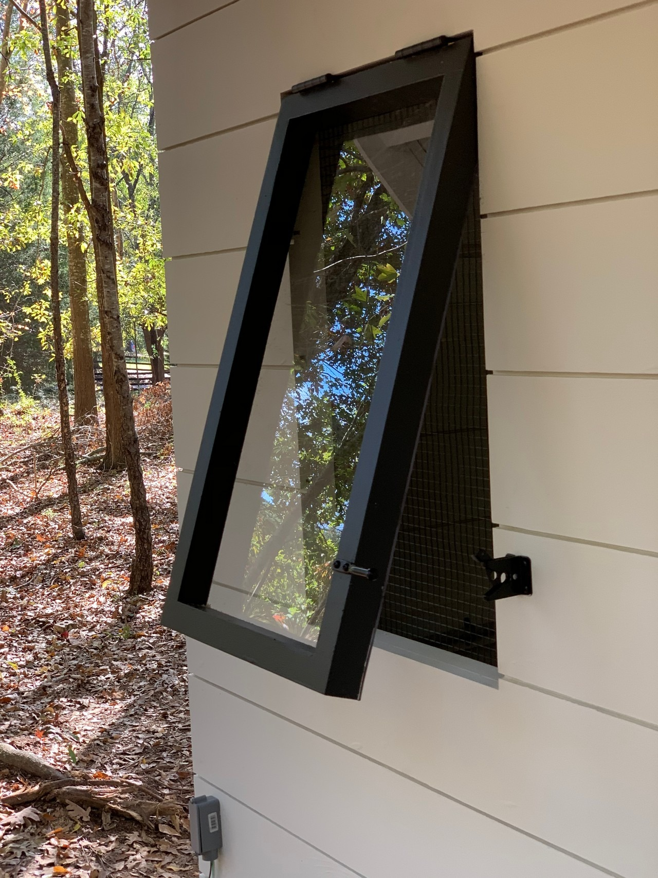close up on the tilt out windows on the modern farmhouse chicken and duck coop in South Carolina