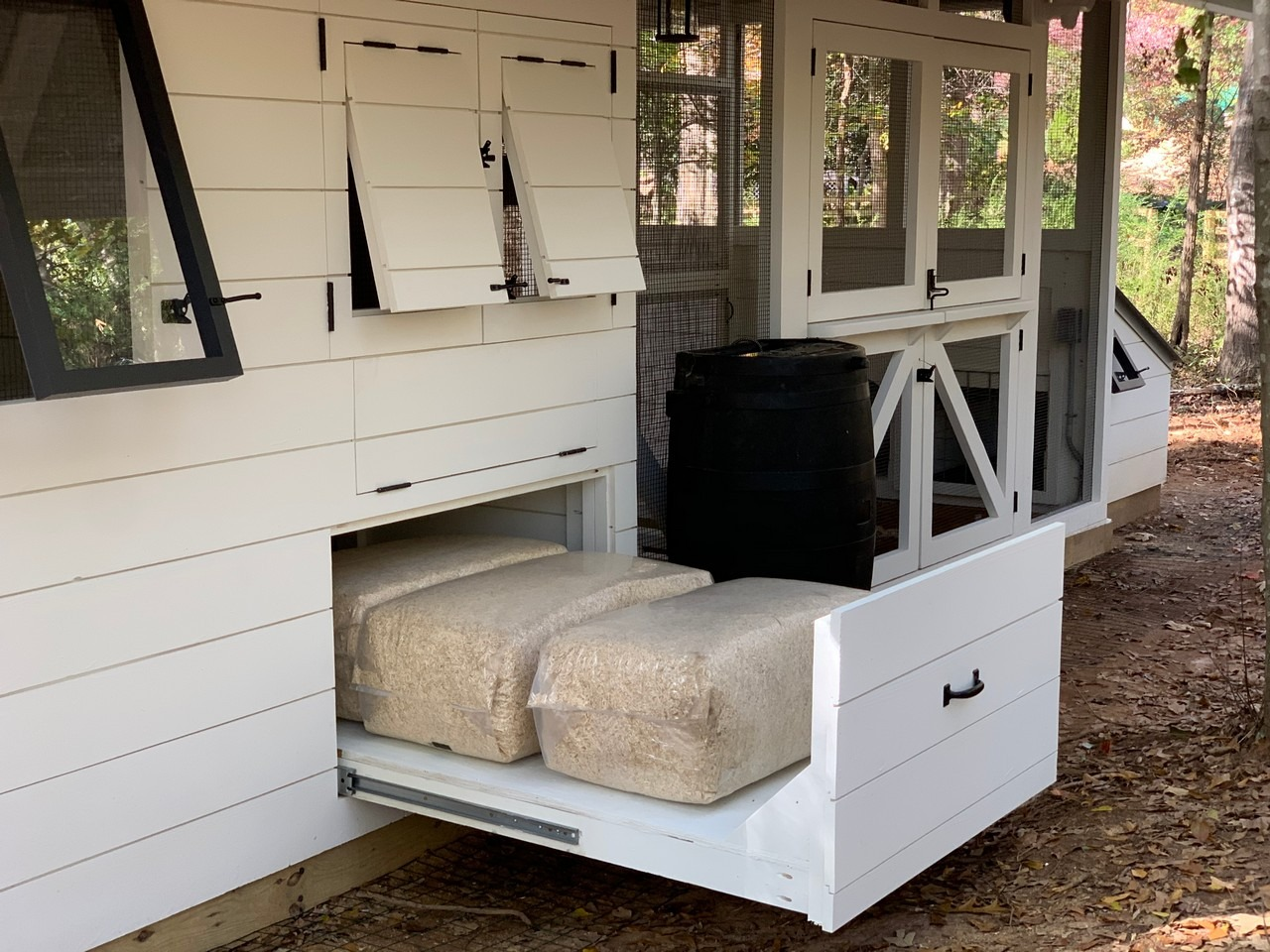 under the henouse storage with roll out drawers on the modern farmhouse custom chicken and duck coop