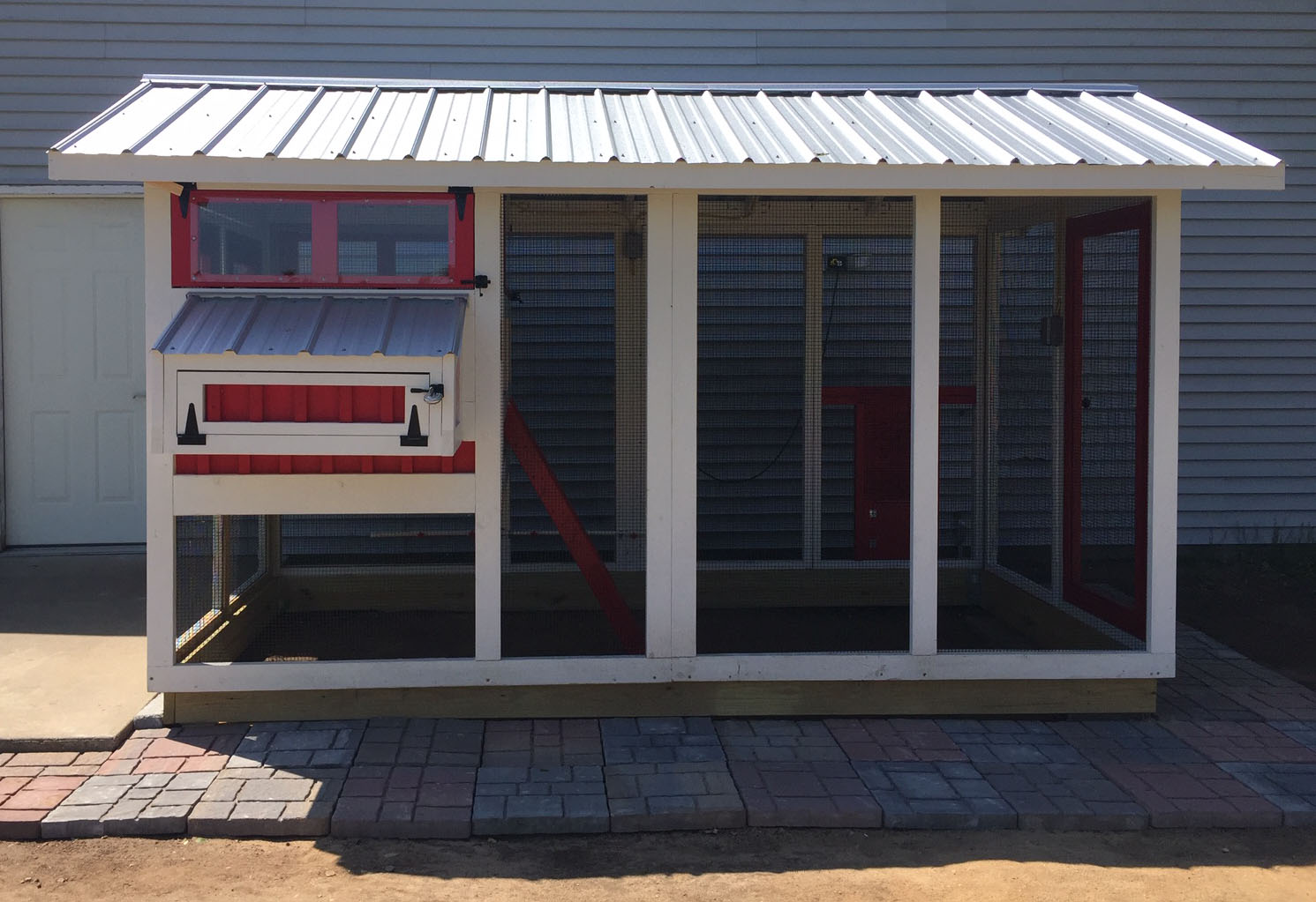 6'x12′ American Coop painted red and white with black hardware and Galvalume roof