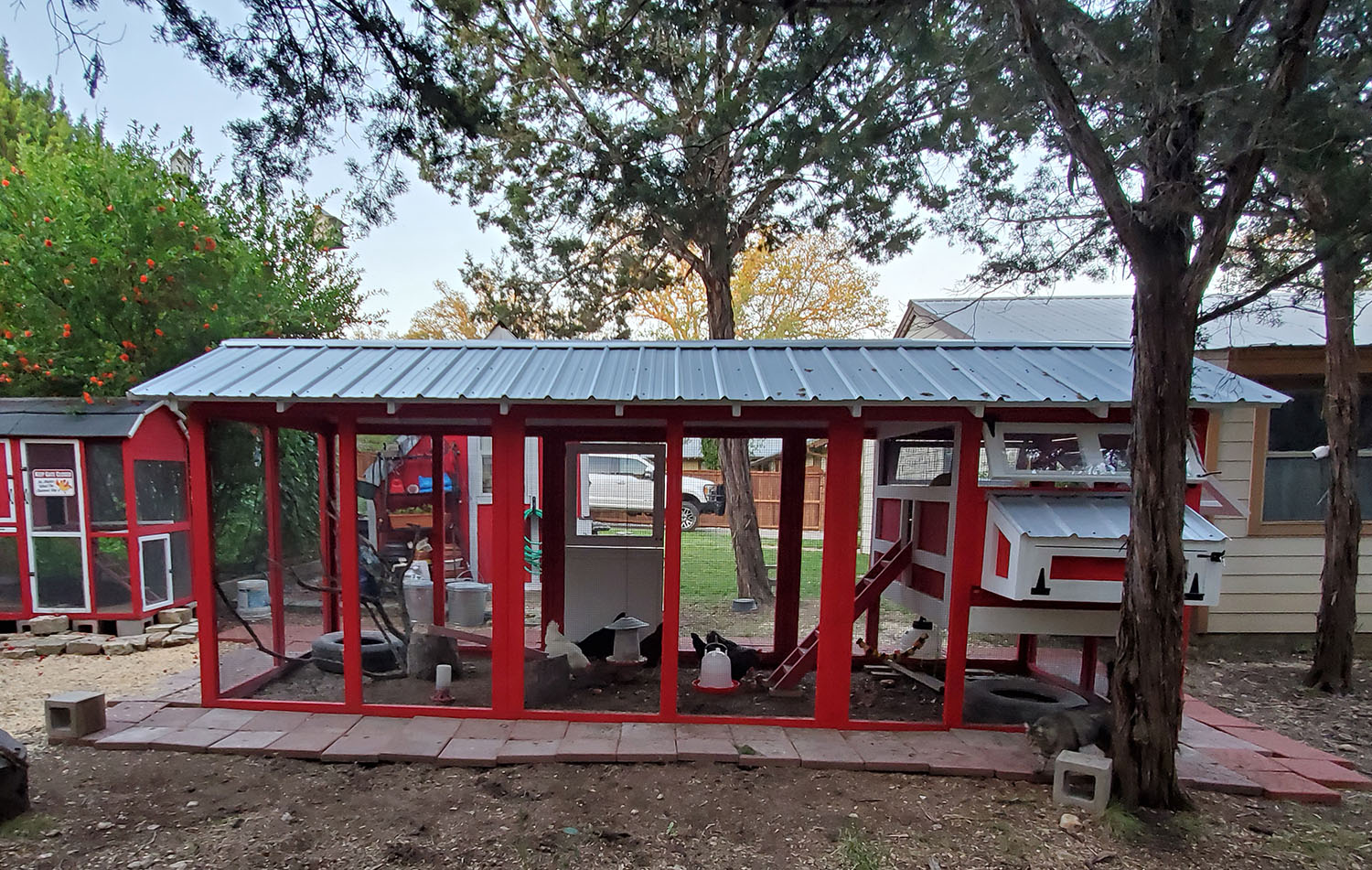 6'x18′ American Coop painted red with white trim