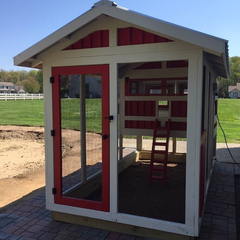 front of 6'x12′ American Coop painted red and white