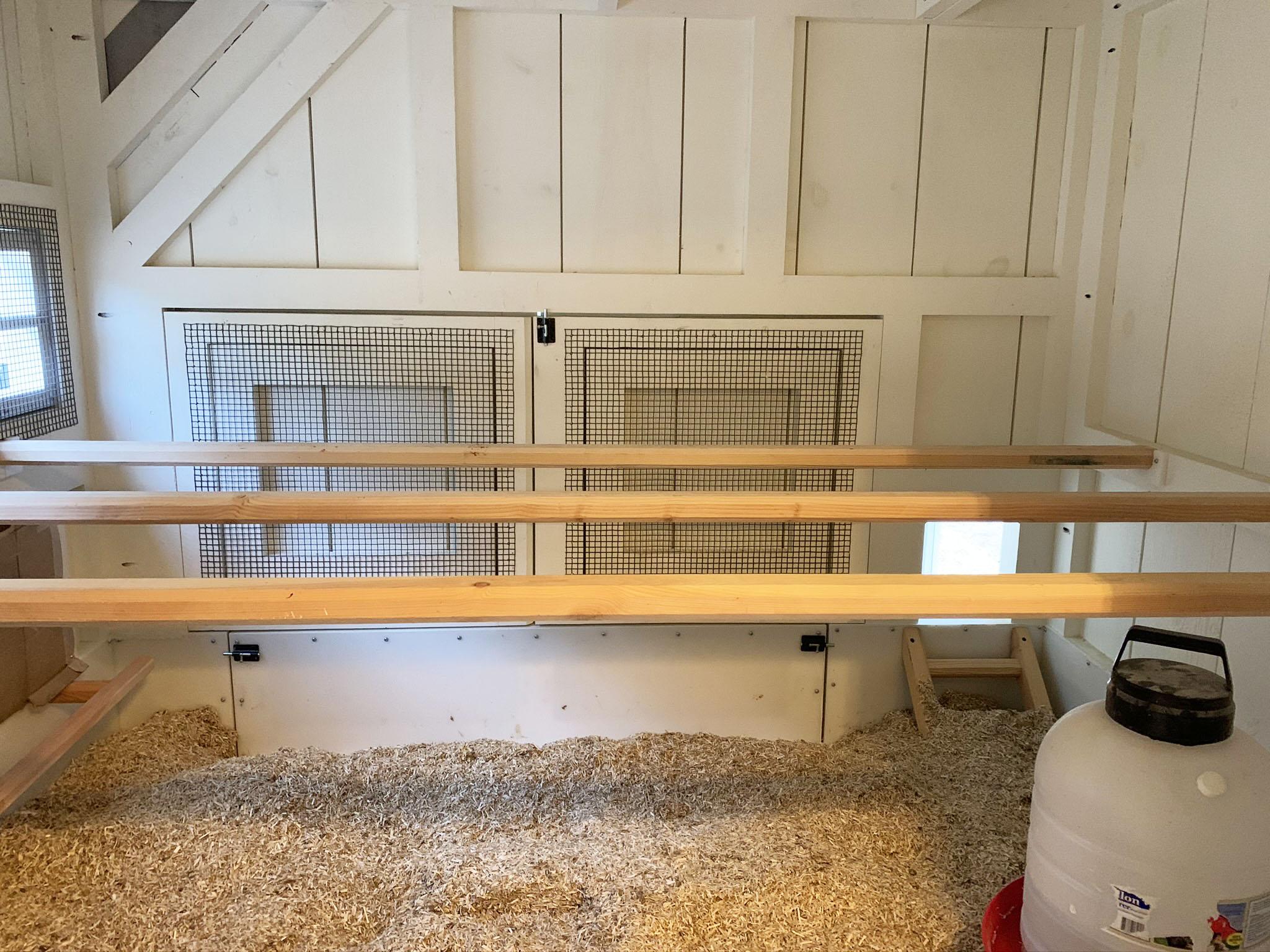 Carolina Coops 10'x30′ Custom Craftsman Coop – inside 4×10 henhouse with three 10-foot roostbars