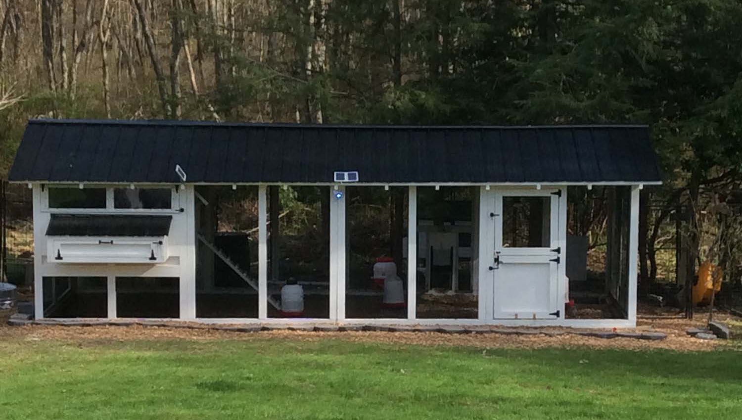 8'x24′ American Coop with 6'x8′ henhouse in Norwell, MA with black roofing & hardware and Dutch door