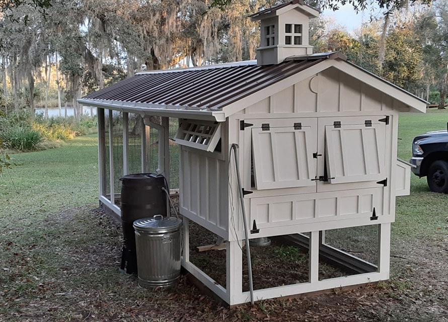 Back of 6×18 Carolina Coop with cupola, Dutch door, and chicken run door in Ormond Beach, Fl