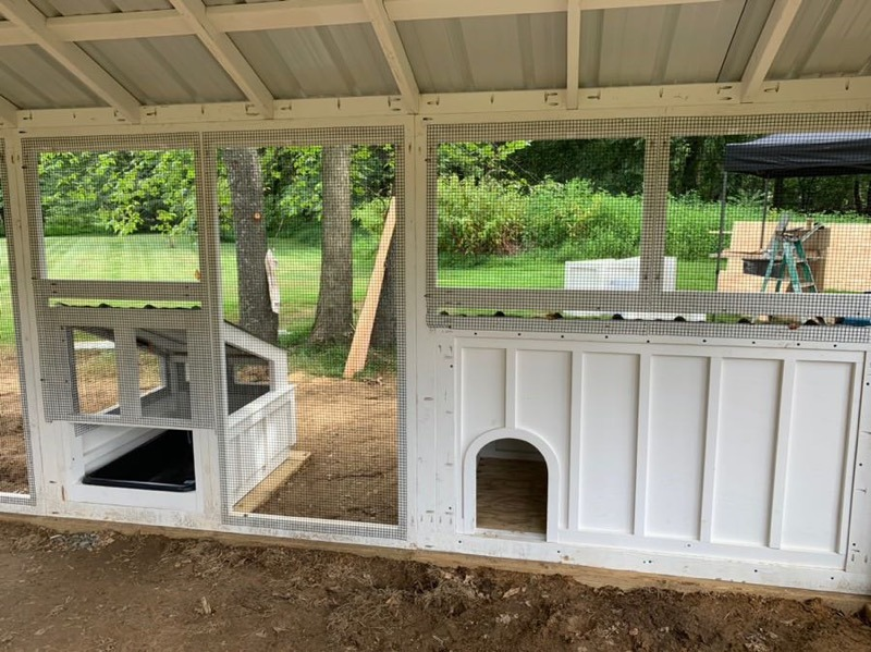 Duck house and duck dipper in the run of a Craftsman Coop