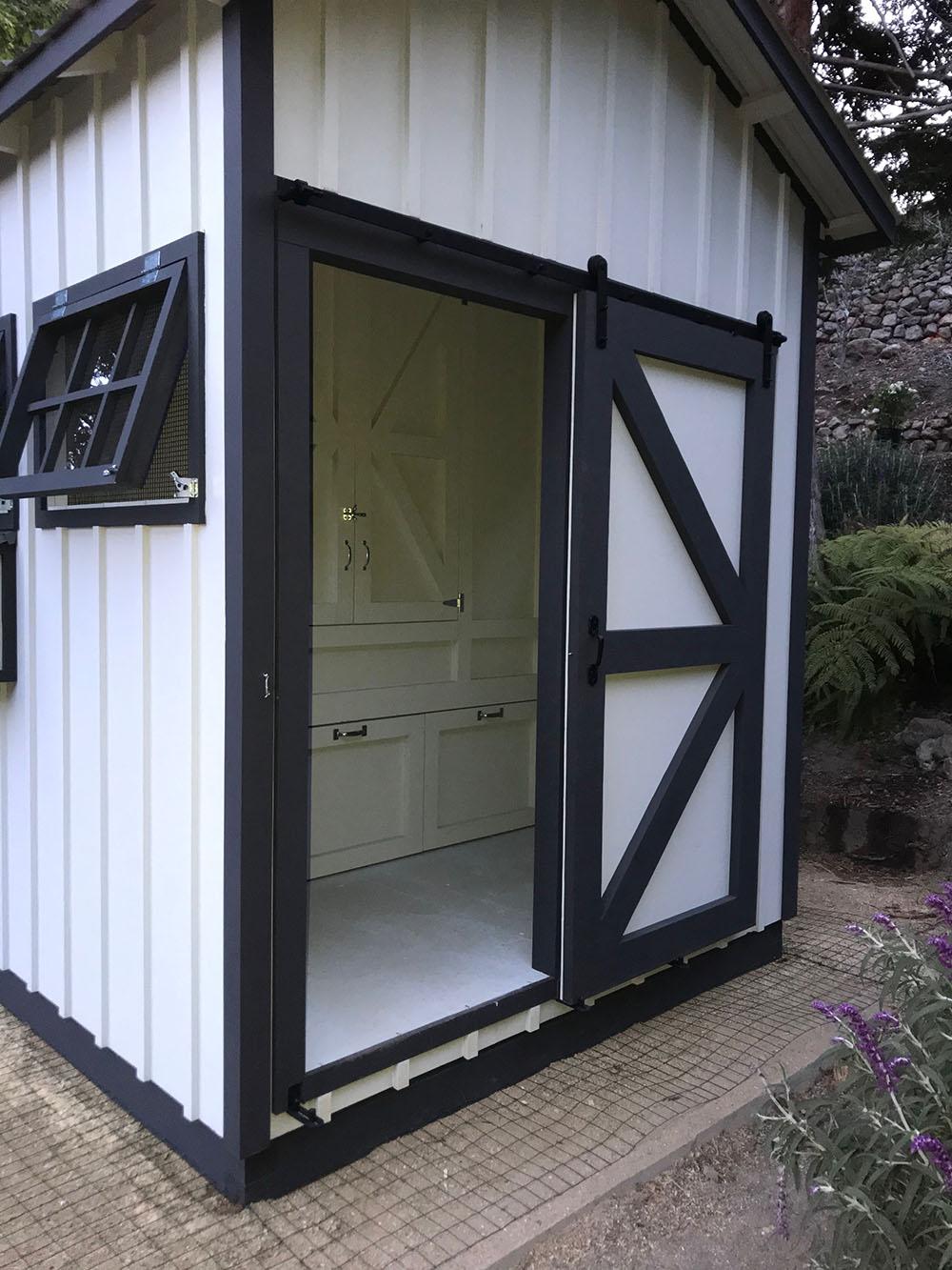 Back of 8'x24′ Craftsman Coop with sliding barn door opened in Malibu, Ca