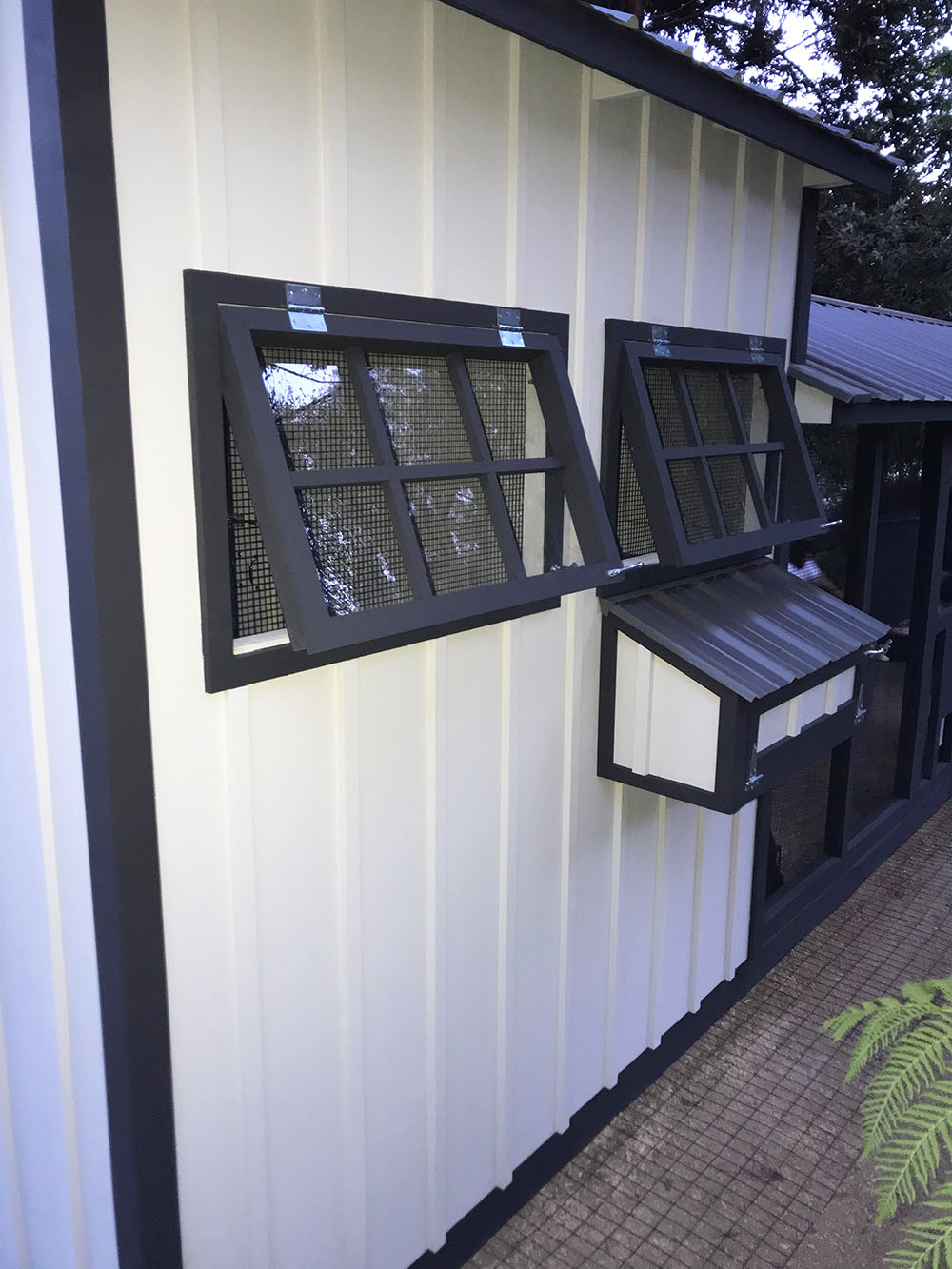 Close up of windows of the 8'x26′ Craftsman Coop in Malibu