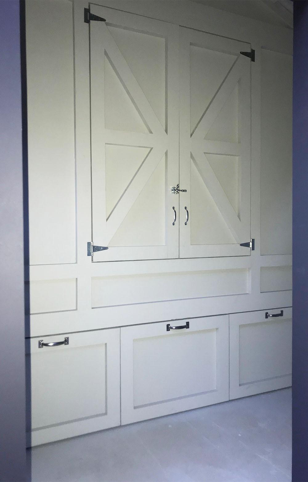 Inside storage and henhouse doors on the 8'x24′ Craftsman Coop in Malibu, Ca