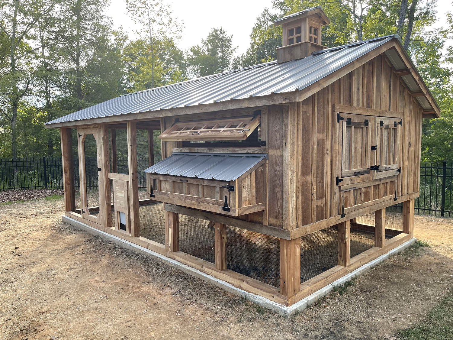 10'x18′ red cedar Carolina Coop in High Point, NC with reclaimed barn wood and chickenguard automatic chicken run door